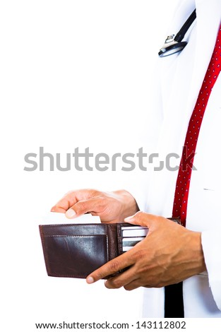 A cropped image of a male doctor holding a wallet and pulling out a card isolated on white background . Health care reform.