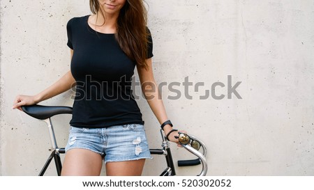 8c873860f76f6 Young woman wearing black sleeveless t-shirt Images and Stock Photos ...