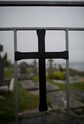 A cross on a gate to a cemetery on Ireland, somewhere on the Ring of Kerry.