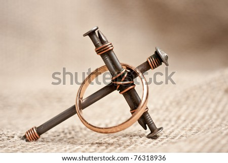 a cross with nails on canvas background