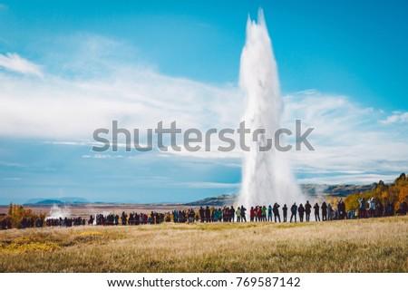A crowd admiring an eruption of Stokkur geyser on Iceland