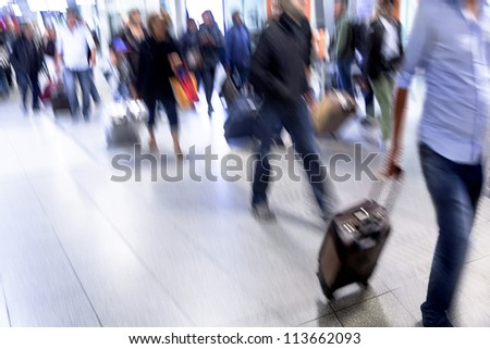 A crowd moving against a background of an urban landscape. Motion blur. Walking businessmen against a background of an urban landscape.