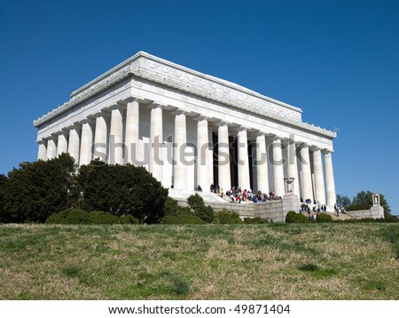 a crowd of people climb the steps to visit the Abraham Lincoln Memorial in Washington DC
