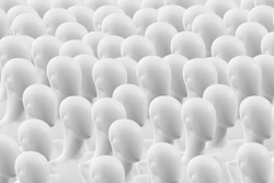 A crowd of people dummies. Concept. Many faceless mannequins heads. People are mannequins. Mannequins without eyes. The concept of human society.