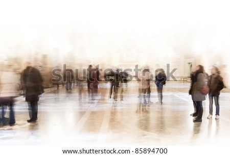 A crowd of people in a museum or at an exhibition - stock photo