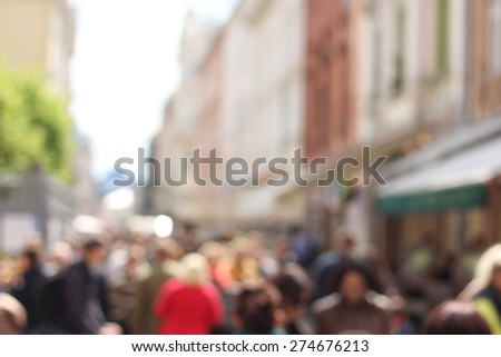 A crowd of people on the street. Street in the city. Traffic movement. Blur, blurred. Dynamics, stress. A lot of people. In the city. The figures of people.