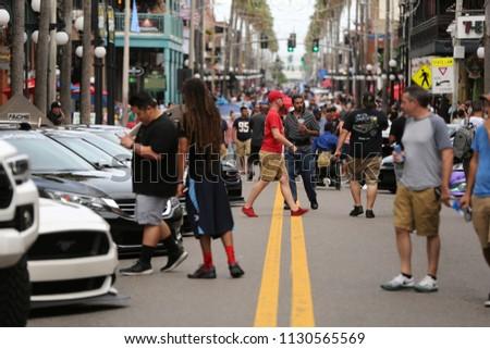 a crowd of people walking in...