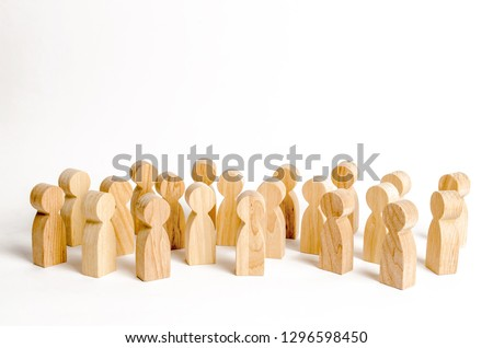 A crowd of wooden figures of people on a white background. Human resource, search for candidates for work. Social survey and public opinion, the electorate. Population and citizens.