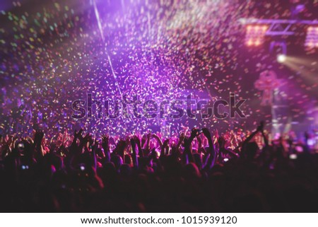 A crowded concert hall with scene stage lights, rock show performance, with people silhouette #1015939120