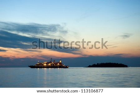 A cruise ship in the twilight in the adriatic sea for the coast of Croatia