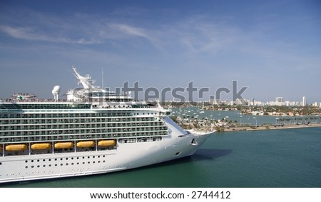 A cruiseship leaving the port - stock photo