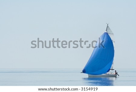 A cruising sailboat in the morning dust