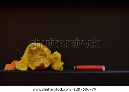 A crushed orange and a lighter #1287686779