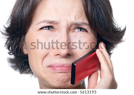 A crying girl with a mobile phone