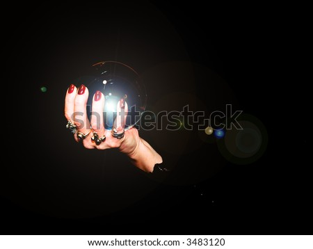 A crystal ball is held in the hands of a fortune teller.