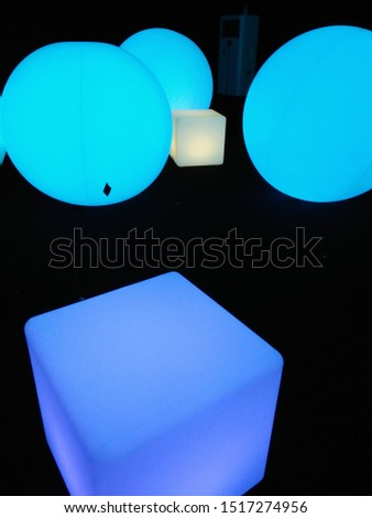A cube watches its friend being engulfed by spheres from a distance.