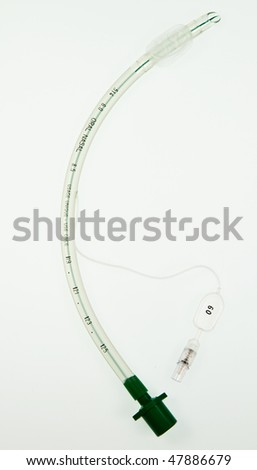 A cuffed endotracheal tube which is passed through the larynx into the windpipe, using a laryngoscope , during an anaesthetic to maintain an airway and supply oxygen and inhaled anaesthetic. - stock photo