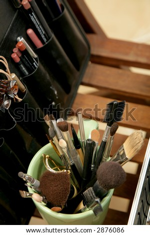 A cup full of makeup brushes and pencils