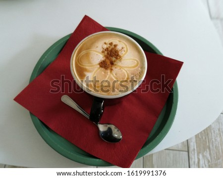 A cup of aromatic cappuccino.