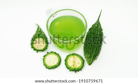A cup of bitter melon, balsam pear, bitter cucumber or bitter gourd on white background is so beautiful