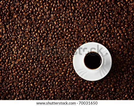 A cup of black coffee on beans background