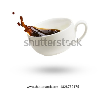 A cup of black coffee with splash isolated on a white background ストックフォト ©