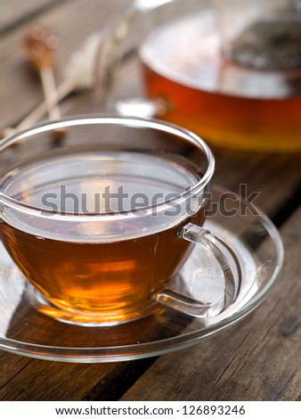 A cup of black tea, selective focus