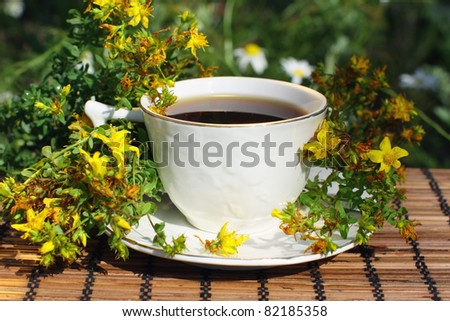 A cup of black tea with herb (Hypericum perforatum).