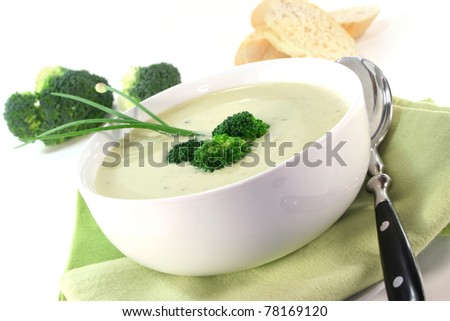 a cup of broccoli cream soup with fresh vegetables