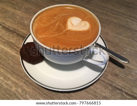A cup of Cafe latte and chocolate cookie #797666815