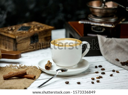 a cup of cappuccino and cinnamon