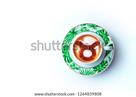 A cup of cappuccino coffee with a zodiac sign Taurus on milk foam