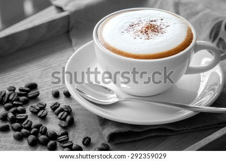 A cup of cappuccino in black and white scene