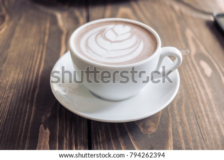 A cup of cofee on the wooden table