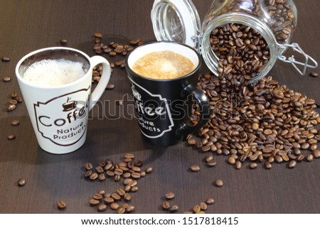 a cup of coffe and coffe beans two cups #1517818415