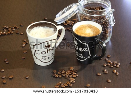 a cup of coffe and coffe beans two cups #1517818418