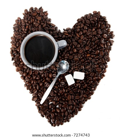 a cup of coffee, a spoon and two sugar cubes over a heart of coffee beans isolated on white