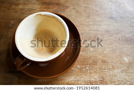 A cup of coffee after drank .put on wooden table.have drank in the morning time. Stockfoto ©