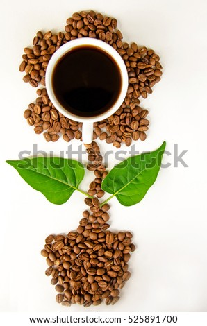 A cup of coffee and coffee beans in the shape of flower pot on white background, idea concept #525891700