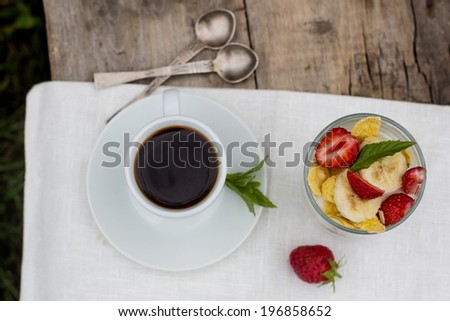 a cup of coffee and dessert  in glass  on the table