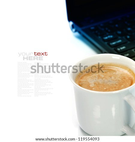 A cup of coffee and laptop over white (with sample text)