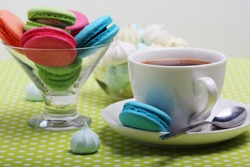 A cup of coffee and macarons