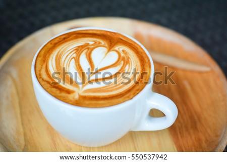 a cup of coffee , cappuccino art , latte art , latte , cappuccino