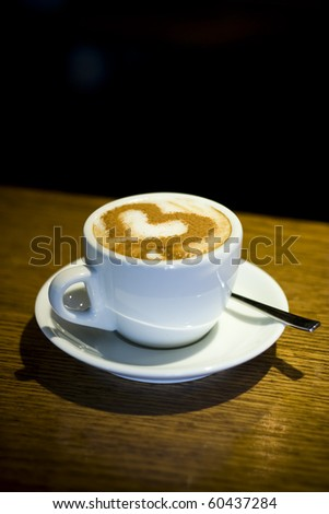 A cup of coffee cappuccino with heart-shaped decoration
