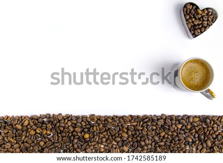 Photo of A cup of coffee. Coffee beans on a white background. free space.