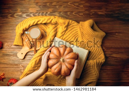 A cup of coffee in cozy rustic autumn atmosphere with book. A cup of coffee in cozy autumn atmosphere with  book. #1462981184