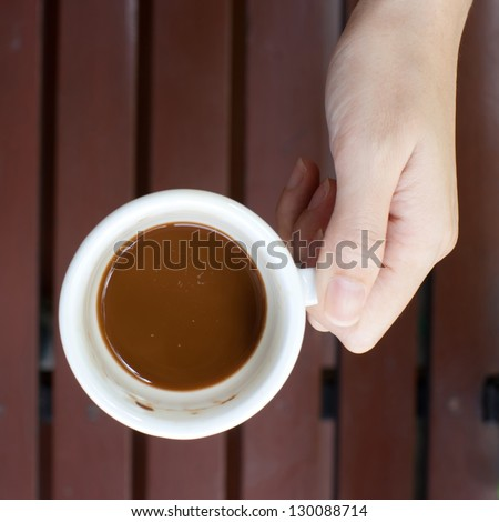 A cup of coffee on hand - stock photo