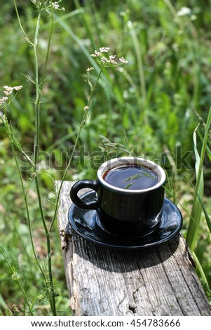 Royalty Free A Cup Of Coffee On The Nature In The 452806687 Stock Photo Avopix Com
