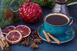 A cup of coffee on the background of New Year's decorations. Christmas and New Years.