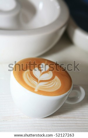 a cup of coffee on the table - stock photo